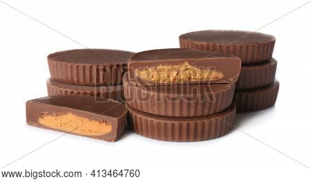 Cut And Whole Peanut Butter Cups Isolated On White