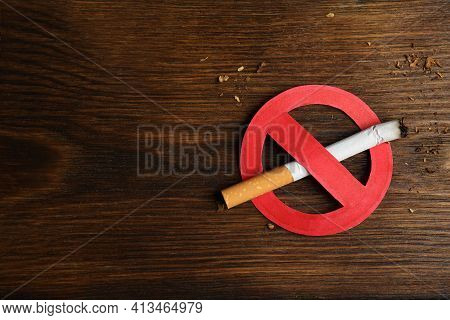 Cigarette With Prohibition Sign And Space For Text On Wooden Table, Top View. Quitting Smoking Conce