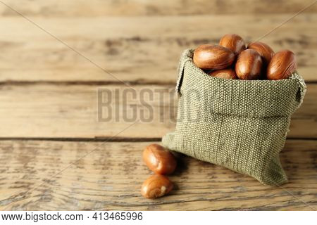 Sackcloth Bag With Jackfruit Seeds On Wooden Table. Space For Text