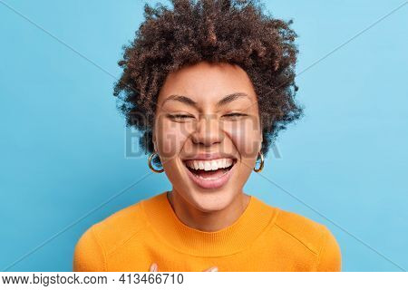 Close Up Shot Of Beautiful Young African American Woman With Natural Curly Hair Smiles Broadly Has P