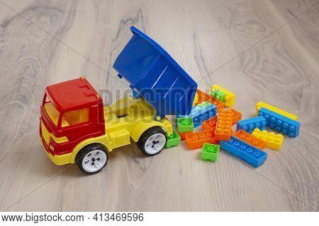 Plastic Toy Truck. Multicolored Children's Toy. Dump Truck.