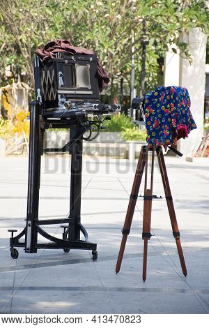 Antique Cameras And Camera Tripod For Show And Thai People And Foreign Travelers Take Photo In Event