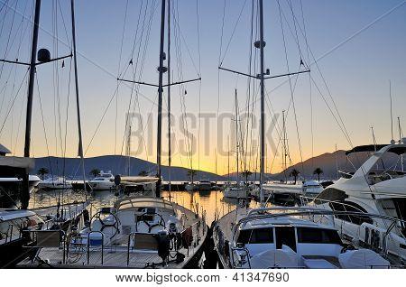 Marina with yachts on sunset