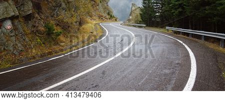 High Altitude Curvy Alpine Road, Crossing From The Rocks To The Abyss In The Distant Horizon. Wide P