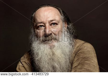 A Wise Old Man With A Long Gray Beard