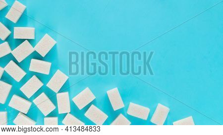 Background Of Sugar Cubes. White Cube Sugar On Blue Background. White Sugar Close Up With Copy Space