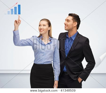 bright picture of man and woman pointing their fingers to chart