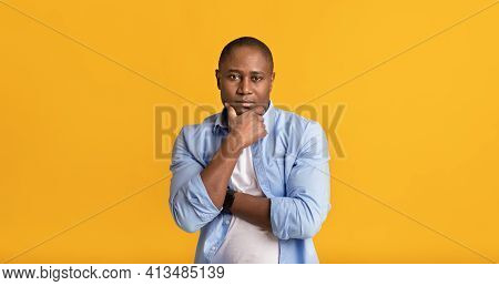 Pensive Adult Smart Attractive African American Guy Rubs Chin, Think About Difficult Question