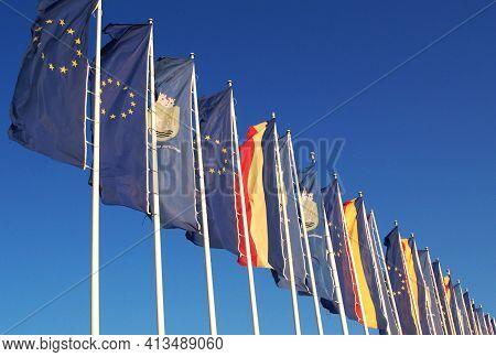 European Union, Romania And Mangalia City Flags At Neptune Beach, In Constanta Region, Romania.