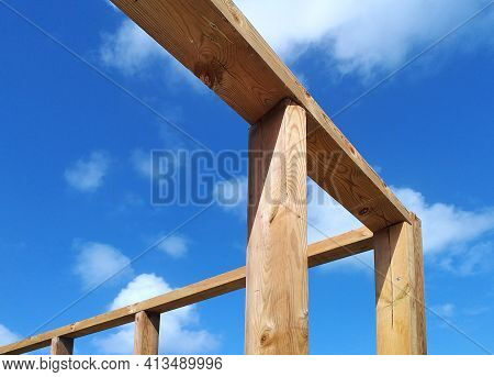 Structural Timber Construction Pillars In The French West Indies. Wooden Structure Under Tropical Bl