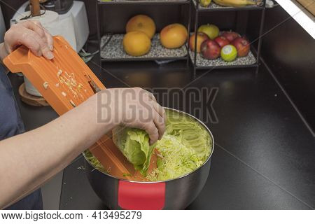 Close Up View Of Woman Shredding Cabbage. Healthy Eating Concept.