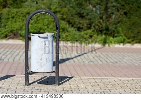 Wastebasket On A Footpath At The Port Of Swinoujscie In Poland