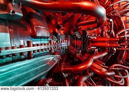 A Modern Gas Turbine Aircraft Engine In A Futuristic Red-green Light.