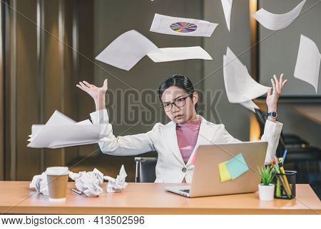 Asian Businesswoman Angry Throwing Papers Over The Herself In Office When Job Fail, Unsuccessful Pro