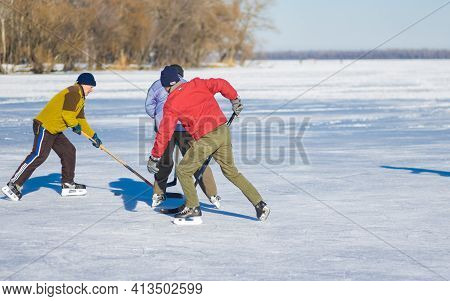 Dnipro, Ukraine - January 22, 2017: Three Mature Man Fighting For The Pack While Playing Amateur Hoc