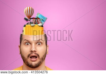 Travel, Vacation Concept. A Creative Image Of A Man In His Head Instead Of A Brain Is Suitcases, Sne