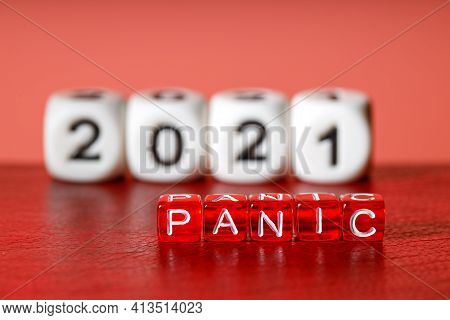 Against The Background Of 2021 The Inscription Panic, The Red Surface Under The Letters. Panic Year