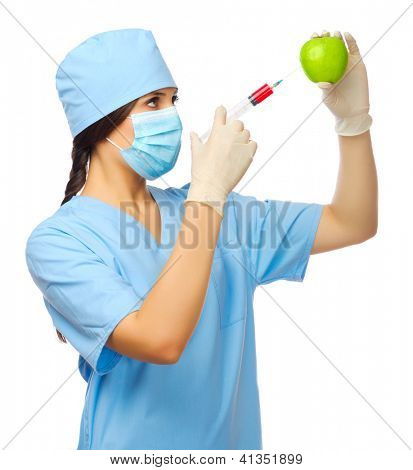 Young doctor with syringe and apple isolated