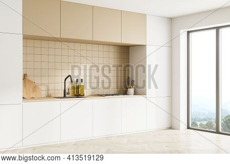 Bright Modern Kitchen Interior With Kitchenware. Parquet Floor And Panoramic Window With Countryside