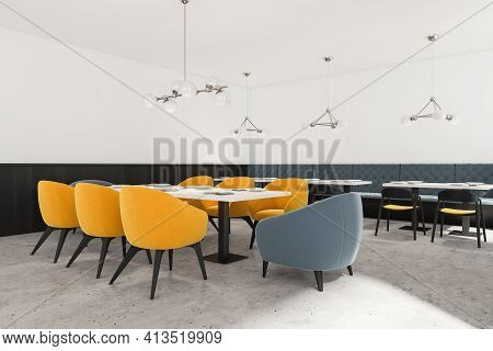 Modern Luxury Cafe Interior With Yellow And Blue Chairs, Side View. Concrete Floor, Minimalist Desig