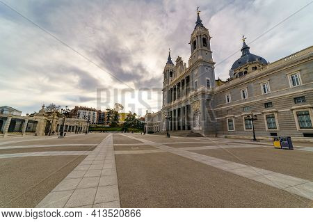 Almudena Cathedral In Madrid And Its Huge Esplanade In Front With Lampposts And Blue Sky. Spain.