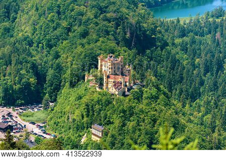 Aerial View Of Hohenschwangau Castle On Mountain Top, Germany, Europe. Alpine Landscape With German