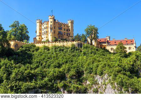 Hohenschwangau Castle On Mountain Top, Germany. Schloss Hohenschwangau Is Famous Landmark Of Bavaria