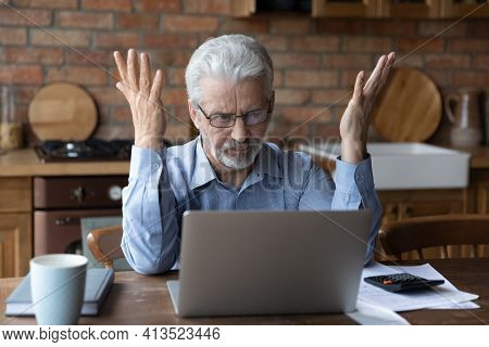 Stressed Old Grandpa Confused With Unexpected Debt On Pc Screen