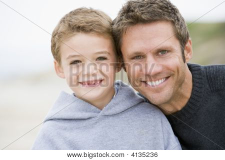 Father And Son At Beach Smiling