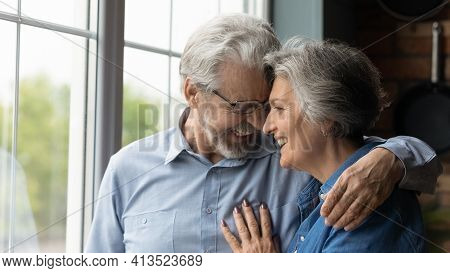 Affectionate Loving Retired Couple Have Date Laugh Cuddle Touch Foreheads