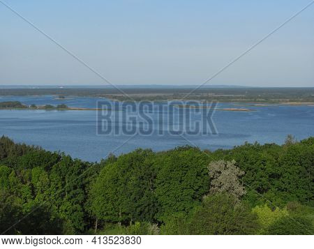 Landscape Background: Green Forest, River With Islands And Blue Sky