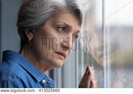 Depressed Elderly Hispanic Lady Widow Mourning For Gone Husband