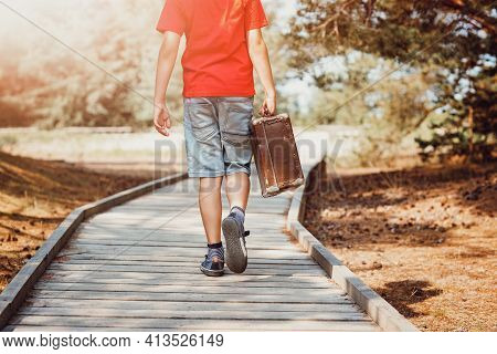 Boy Walking In Nature In Beautiful Summer Day. Child With Luggage. Travel And Vacations Concept