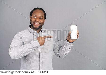 Portrait Of Cheerful, Positive, Attractive African American Guy With Stubble In Casual Shirt, Having