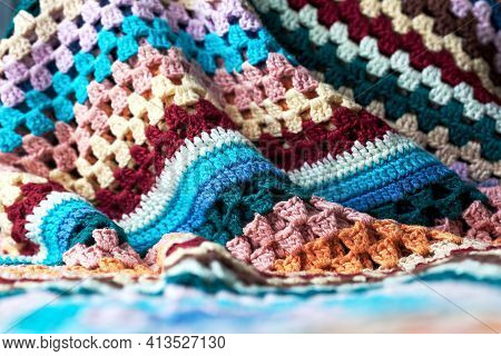 Crumpled Multicolored Knitted Blanket. Crumpled Soft Fabric. Texture For The Background. Selective F