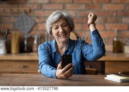 Overjoyed Aged Latin Grandmother Yell Celebrate Winning Mobile Phone Game