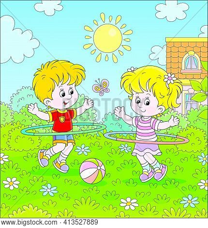 Cheerful Cute Little Kids In Colorful Sport Clothes Playing And Fun Spinning Hoops On A Green Lawn O