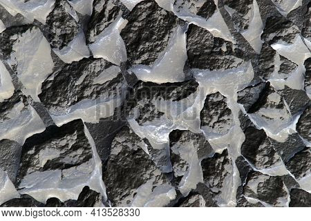 Rock Wall Background. Painted Rock and Pebble Wall Background. Small Rough Shaped Rocks.
