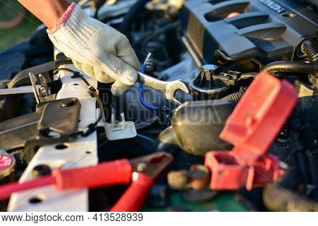 A Wrench In The Hands Of A Mechanic Preparing To Fix The Machine Of The Car, Fix The Breakdown At Th