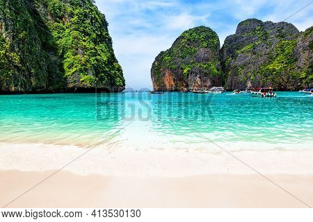 Beautiful Beach With Thai Traditional Wooden Longtail Boat And Blue Sky In Maya Bay, Thailand. Vacat