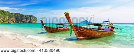 Panorama Of Thai Traditional Wooden Longtail Boat And Beautiful Sand Beach At Koh Phi Phi Island In