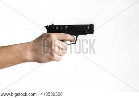 Pistol, Or Auto-loader Short Gun In Female's Hand Preparing Or Self Loading Prompt To Use