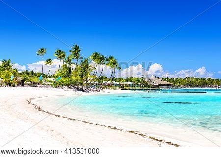 Beautiful White Sandy Beach In Cap Cana, Dominican Republic. Coconut Palm Trees On White Sandy Beach