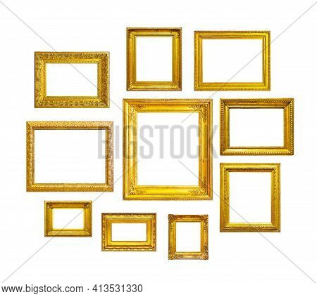 Golden Vintage Frames On White Background. Set Of Golden Frames For Paintings, Mirrors Or Photo Isol