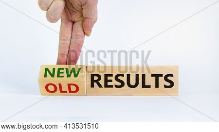 New Vs Old Results Symbol. Businessman Turns The Wooden Block And Changes Words 'old Results' To 'ne