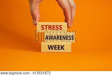 Stress Awareness Week Symbol. Wooden Blocks With Words 'stress Awareness Week'. Beautiful Orange Bac