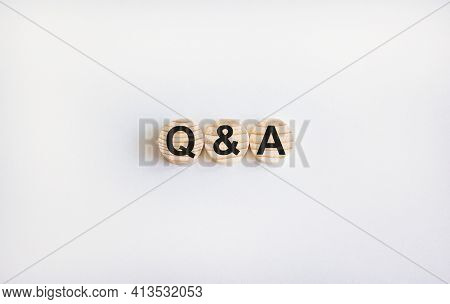 Q And A Questions And Answers Symbol. Concept Words 'q And A' On Wooden Circles On A Beautiful White