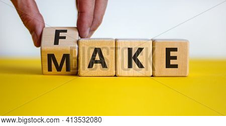 Fake It Until You Make It Symbol. Businessman Turns A Cube And Changes The Word 'fake' To 'make'. Be