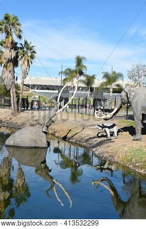 LOS ANGELES - NOVEMBER 24, 2017:  Lake Pit at the La Brea Tar Pits.  Pleistocene mammoth statues depict how animals became trapped in the tar.