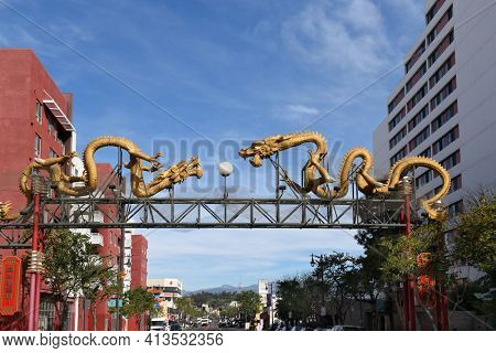 LOS ANGELES, CALIFORNIA - 05 FEB 2020: Twin Dragon Gate on Broadway leads into the heart of Chinatown. Chinese characters translate to Welcome.
